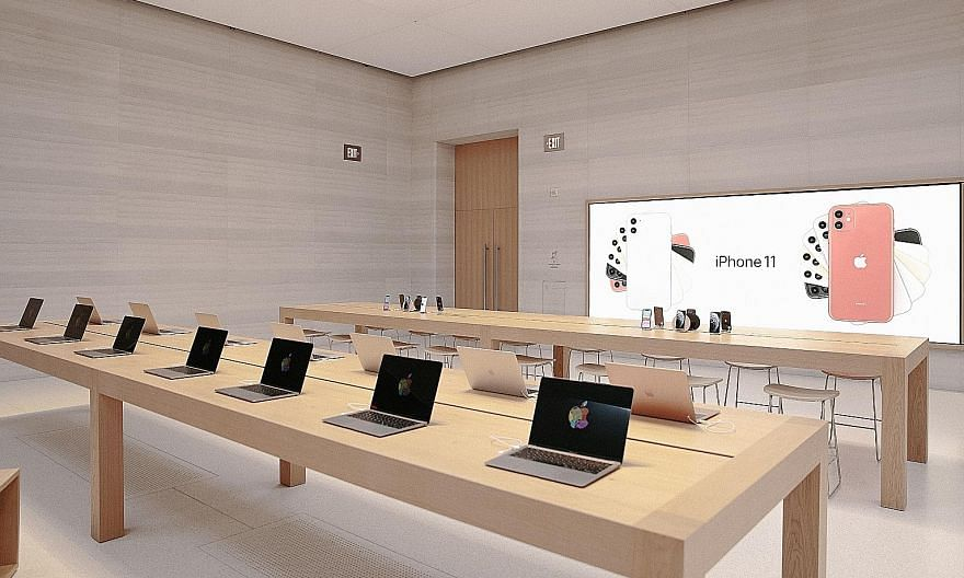 Apple laptops inside the company's Fifth Avenue store in New York. The company moving to use its own chips in Macs ends a nearly 15-year reliance on Intel Corp to supply processors for its flagship laptops and desktop.