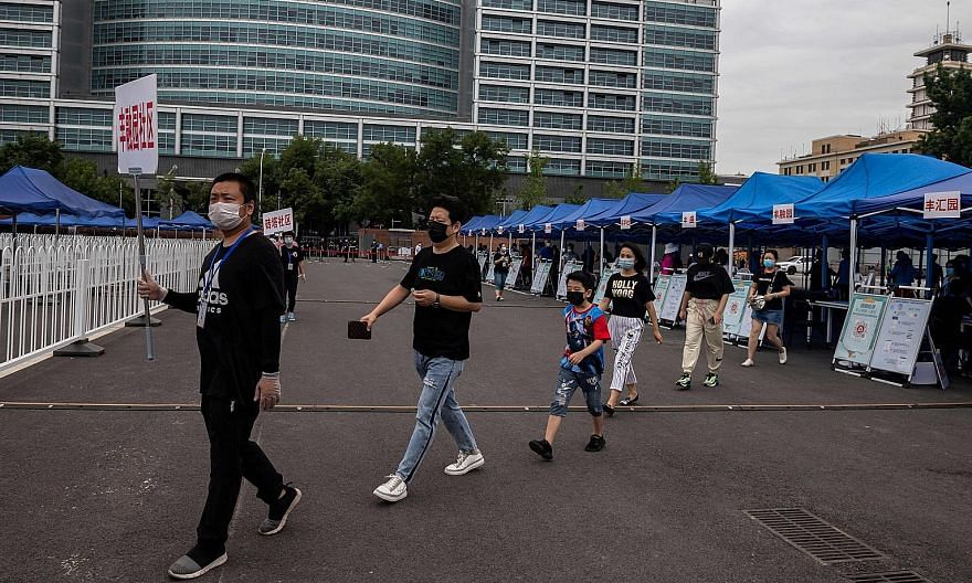 A mass Covid-19 testing site in Beijing on Wednesday. Infectious disease experts say the city's swift response at the beginning of the outbreak has made a difference in keeping the case numbers low. Beijing's Communist Party secretary Cai Qi, who out