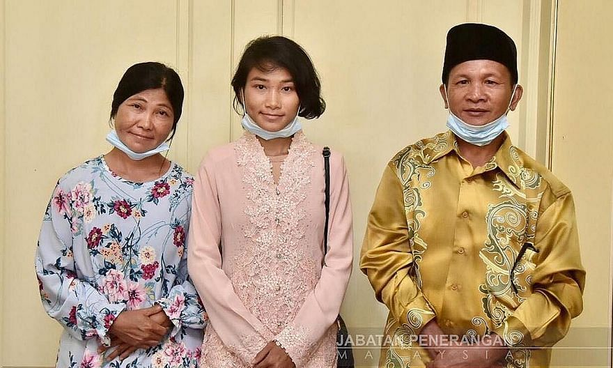 Veveonah Mosibin with her parents, Mr Mosibin Makrun and Ms Rofinah Ungo. The teenager's treetop video has opened up opportunities for her while also highlighting the lack of facilities in many parts of the Borneon state she lives in. PHOTO: SABAH IN