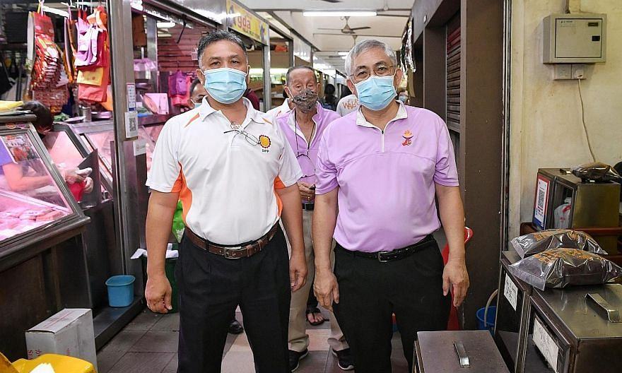 Democratic Progressive Party secretary-general Mohamad Hamim Aliyas (at left), accompanying People's Power Party secretary-general Goh Meng Seng, who is contesting MacPherson SMC, on his walkabout at MacPherson Market and Food Centre yesterday.