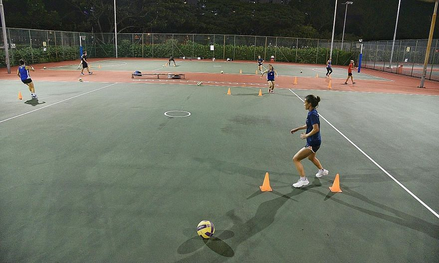 The national netball teams resuming training at the Kallang Netball Centre last Tuesday. The 24 members of the Open and A-teams were split into groups and occupied six courts for their first court session in over two months.