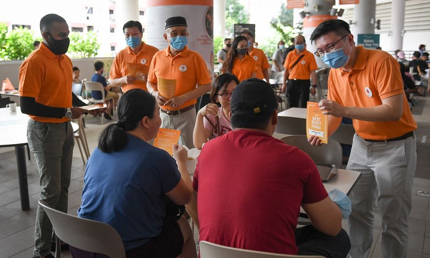 (From far left, in orange) The NSP's Mr Sathin Ravindran, Mr Sebastian Teo, Mr Yadzeth Hairis and secretary-general Spencer Ng on a walkabout at Kampung Admiralty Hawker Centre in Sembawang GRC yesterday. They are expected to be in the NSP's line-up