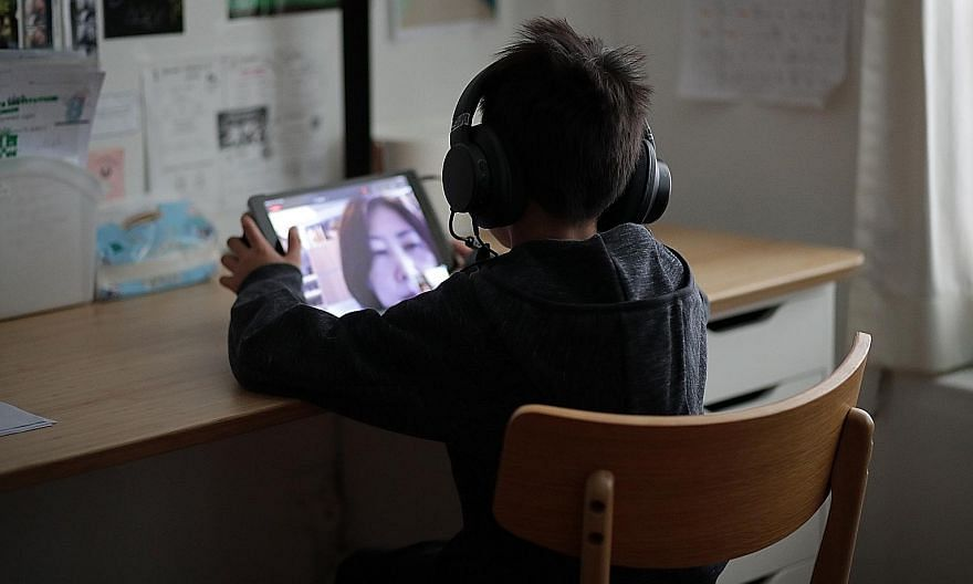 A boy attending an online meeting using an iPad during home-based learning in May. Video-conferencing tools used in HBL can be a boon for shy kids, who feel less stage fright when speaking in class.