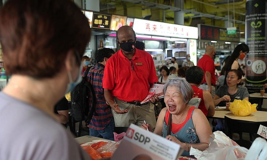 Singapore Democratic Party chairman Paul Tambyah during a walkabout at Bukit Panjang Hawker Centre and Market yesterday. He said Bukit Panjang residents have told him about the need for improvements to bus services in the area while some living near