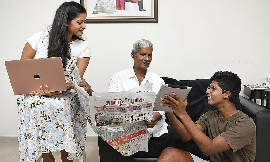 Tamil Murasu journalist Indu Elangovan, 24, at home with her 62-year-old father, Mr R.I. Elangovan, who has distributed newspapers - including Tamil Murasu and The Straits Times - in Singapore for 23 years. With them is her brother, Eniavan Elangovan