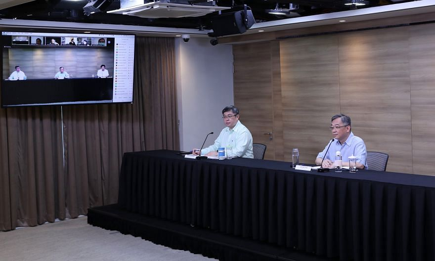 Singapore's top medical authority, the director of medical services at the Health Ministry, Associate Professor Kenneth Mak (far left), seen here with Health Minister Gan Kim Yong at a press conference last week on the Covid-19 pandemic. PHOTO: MINIS