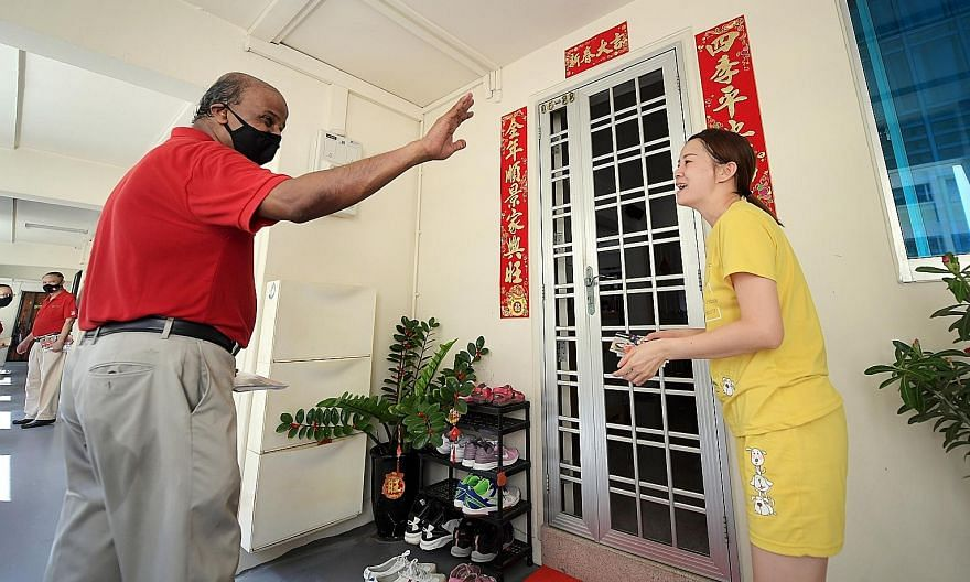 Singapore Democratic Party chairman Paul Tambyah, who is contesting in Bukit Panjang SMC, visiting residents yesterday. Five Pofma notices were issued over comments made by Prof Tambyah last Friday at an NUSS forum. All five parties have complied wit
