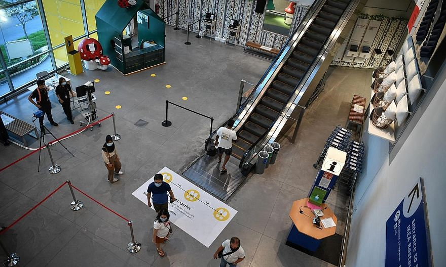 Thermal scanners at Ikea Tampines to screen shoppers. Retailers report a mixed showing, with some stores seeing more shoppers, while others say traffic peaked in the first week of phase two. ST PHOTO: ARIFFIN JAMAR