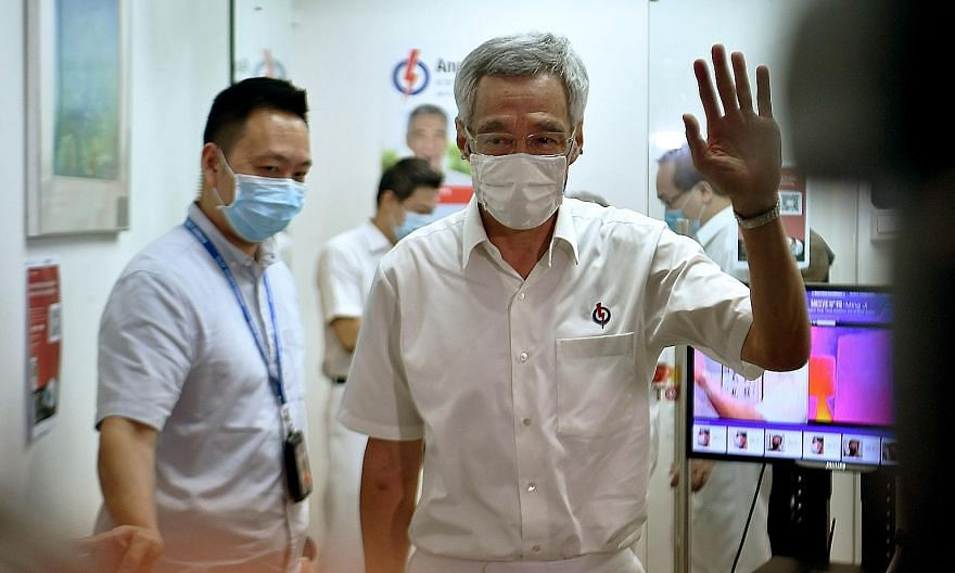 Prime Minister Lee Hsien Loong leaving the PAP Teck Ghee branch at Block 322 Ang Mo Kio Avenue 3 after the press conference, which was streamed live on the Ang Mo Kio GRC's Facebook page. He and his team thanked residents for their support and the op