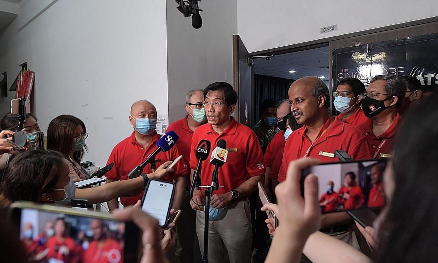 Singapore Democratic Party chief Chee Soon Juan and chairman Paul Tambyah making a statement to the media at the party headquarters in Ang Mo Kio at about 1.40am, even before the results were confirmed, conceding defeat after the sample counts indica