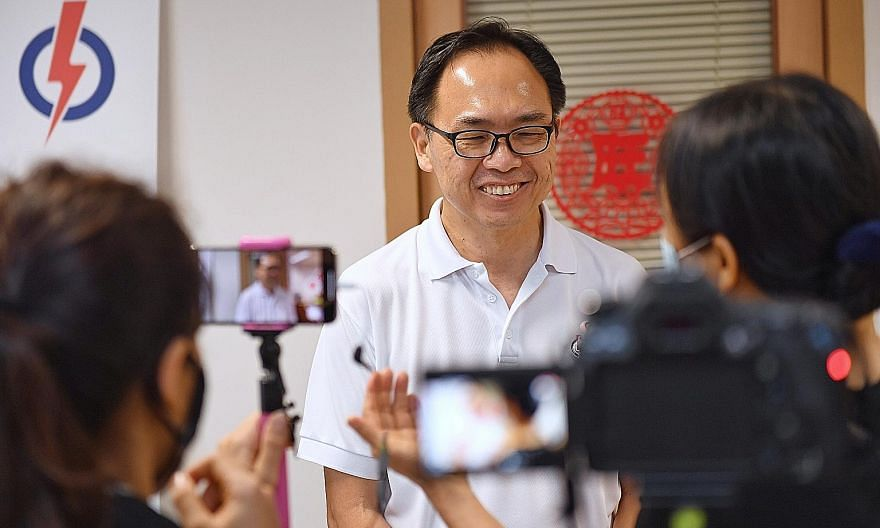The PAP's Mr Liang Eng Hwa arriving at the party's headquarters in Gangsa Road early this morning after he won 53.74 per cent of the votes in Bukit Panjang against SDP chairman Paul Tambyah, who scored 46.26 per cent.