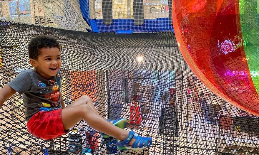 It is playtime for this child at Airzone, an indoor suspended net playground.