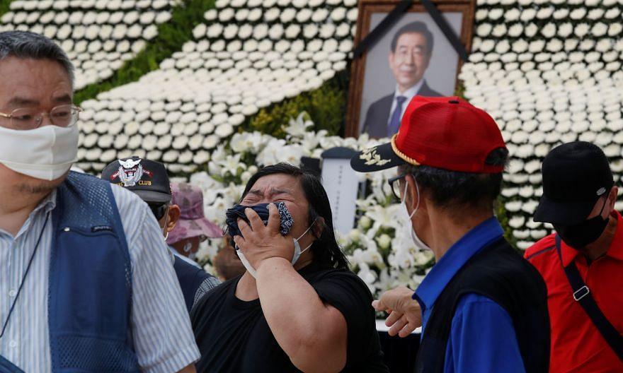 A woman grieving at a memorial altar for the late Seoul mayor Park Won-soon at Seoul City Hall Plaza yesterday. Mr Park's body was found in the woods of Mount Bugak in northern Seoul early on Friday, after he was reported missing the day before. It a