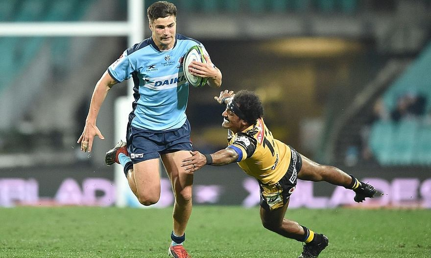 Waratahs player Jack Maddox avoids a tackle by Western Force player Marcel Brache during the Super Rugby match between Australia's Waratahs and Western Force in Sydney last Saturday. PHOTO: AGENCE FRANCE-PRESSE