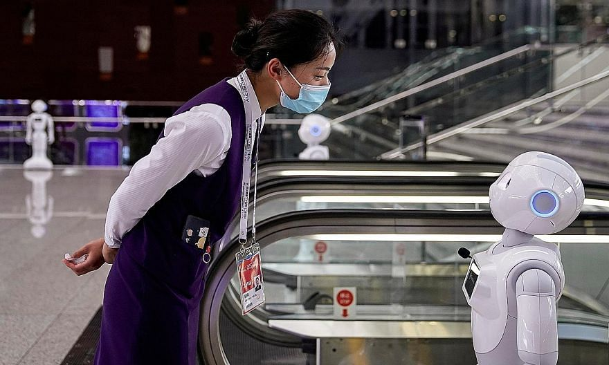 A robot at the World Artificial Intelligence Conference in Shanghai on July 9. The writer says that while most observers would agree that technology driven by artificial intelligence improves lives, just as many now fear its impact on jobs and incomes.