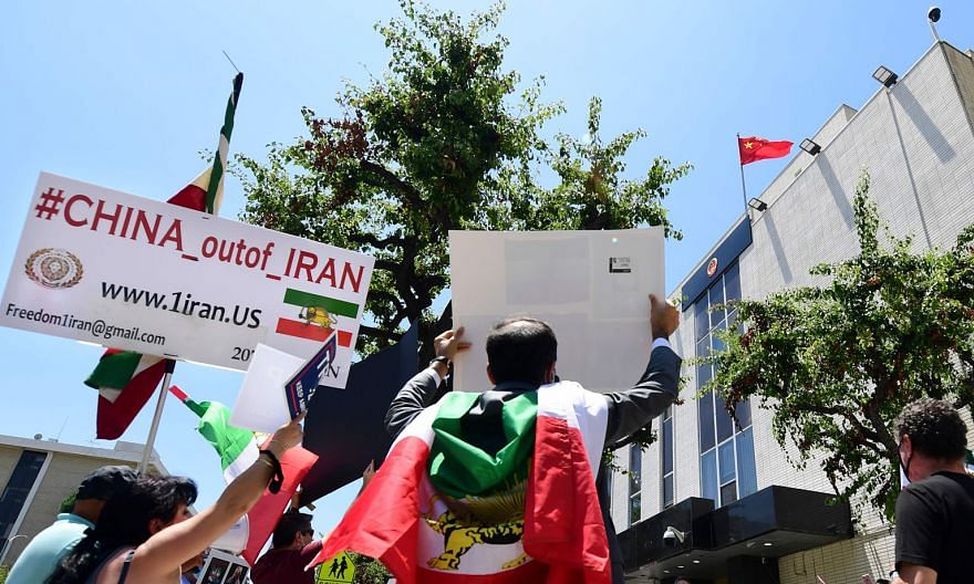 Iranian-Americans protesting in front of the Chinese Consulate in Los Angeles this month against China's bypassing of US sanctions in doing business with Iran. The news of a purported secret deal between China and Iran has led critics in the Islamic
