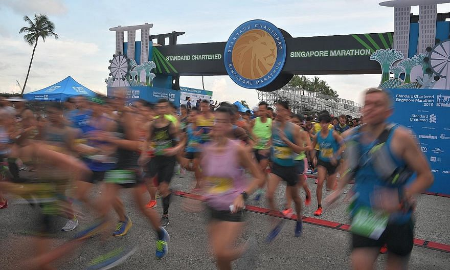Elite runners getting off the start line at last year's Standard Chartered Singapore Marathon. It is looking increasingly unlikely that the country's largest mass participation sports event will take place in its traditional format while the Covid-19