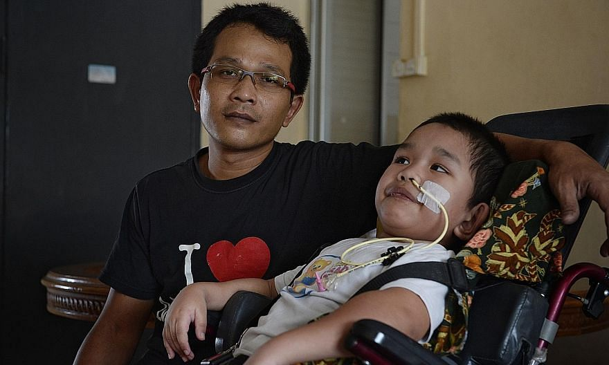 Mr Abdul Halim Abdul Aziz and his son Syahriz Matin Abdul Halim in a 2016 photo. Syahriz, who is now 12 years old, lost his motor skills and ability to speak as a result of the swimming pool accident in October 2015.