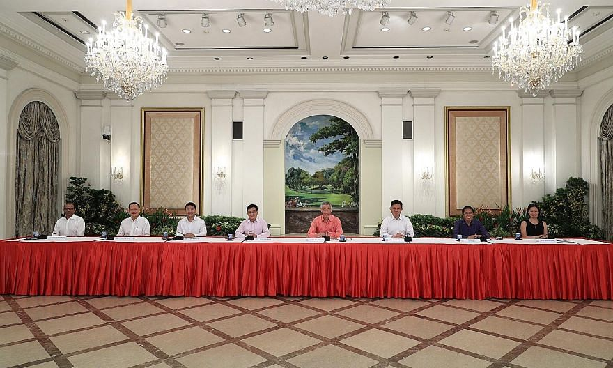 Prime Minister Lee Hsien Loong at a press conference live-streamed from the Istana yesterday, with (from left) Dr Janil Puthucheary, Dr Tan See Leng, Mr Desmond Lee, Mr Heng Swee Keat, Mr Chan Chun Sing, Dr Maliki Osman and Ms Gan Siow Huang.