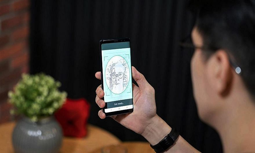 Private-sector organisations, such as DBS Bank, can now tap the nation's digital identity infrastructure to securely verify online transactions. PHOTO: DBS