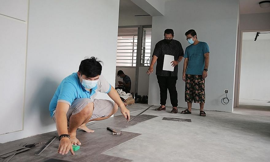 Renodiction's founder Azri Abbas having a discussion with home owner Abdul Hadi (right), in Mr Hadi's four-room Build-To-Order flat in Sengkang last Saturday. The renovation works were expected to be completed by the end of May, but this has been del