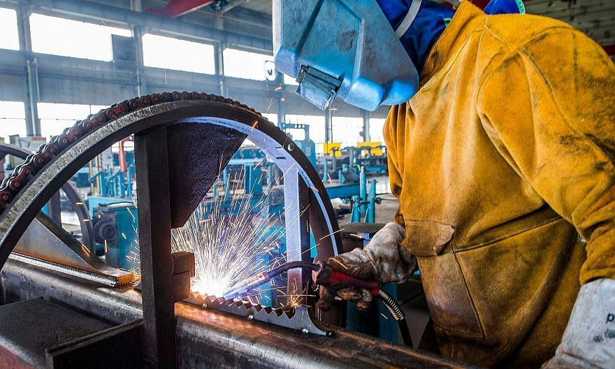 A worker welding machine parts at a factory in Weifang city, in China's eastern Shandong province. Manufacturing activity in China last month expanded at the fastest pace in nearly a decade, suggesting that the world's second-largest economy will hel