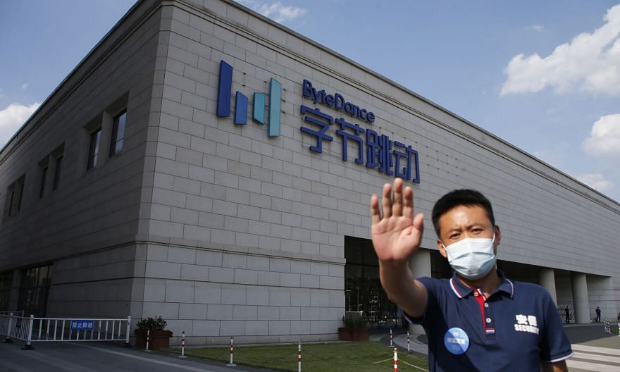 A security guard outside ByteDance's headquarters in Beijing, China. The company owns TikTok, which is being threatened with a ban by the US. PHOTO: EPA-EFE