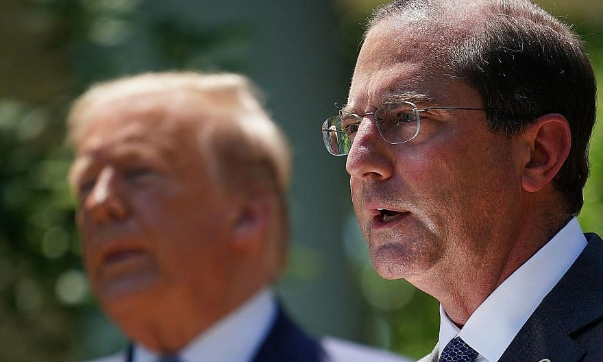 US Secretary of Health and Human Services Alex Azar (at right) at the White House in Washington with President Donald Trump in May. Mr Azar's planned visit to Taiwan comes at a time when US-China ties are at an all-time low. PHOTO: AGENCE FRANCE-PRES