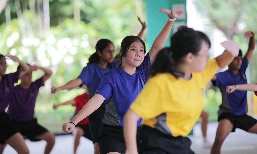 Secondary 2 students from Chua Chu Kang Secondary School taking part in a wushu session on Wednesday. The session is one of the school's enrichment programmes that are conducted in person and at a class level for all Secondary 1 to Secondary 3 classe
