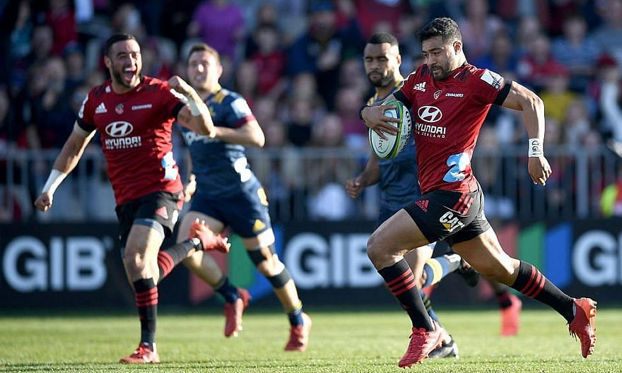 George Bridge scoring one of his two tries in the final quarter to help the Canterbury Crusaders come from behind to beat the Otago Highlanders 32-22 and win the Super Rugby Aotearoa title in Christchurch yesterday.