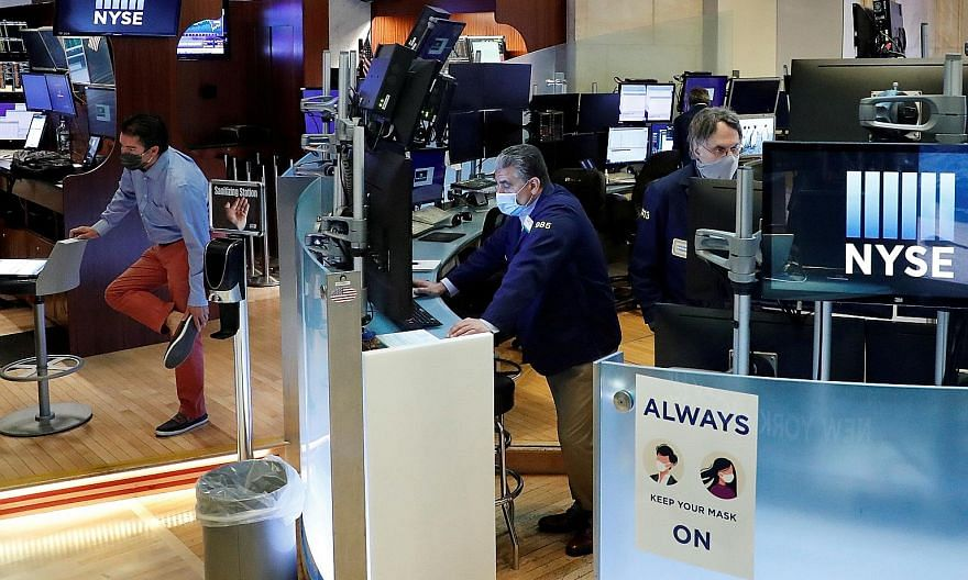 Traders at the New York Stock Exchange in May. The writer says a unified Republican government would be more positive for stocks in the US, but a Democrat government would not necessarily be negative for equities. PHOTO: REUTERS