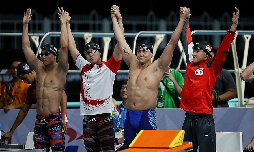 """Olympic champion Joseph Schooling (second from right) and Quah Zheng Wen (extreme right) can continue to train """"unhindered"""" for the Tokyo Games after Mindef granted the pair extensions to their national service deferments."""