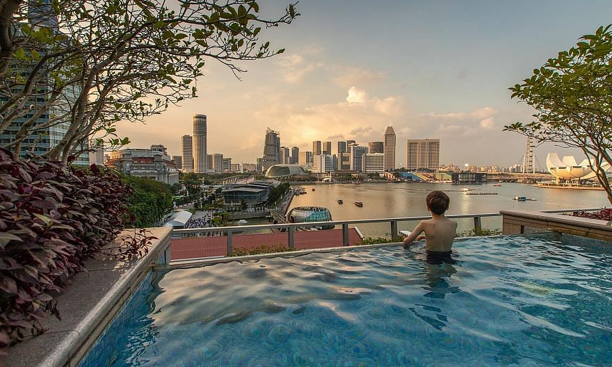 The Premier Bay View Room (above) at The Fullerton Bay Hotel. Book a slot for the rooftop pool for the best wraparound views.