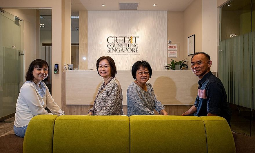 Credit Counselling Singapore (CCS) general manager Tan Huey Min (second from left) with her colleagues (from left) Catherine Siah, Tang Lai Pin and Jonathan Peh. Since 2004, CCS has helped more than 32,000 people manage their finances better. Those w