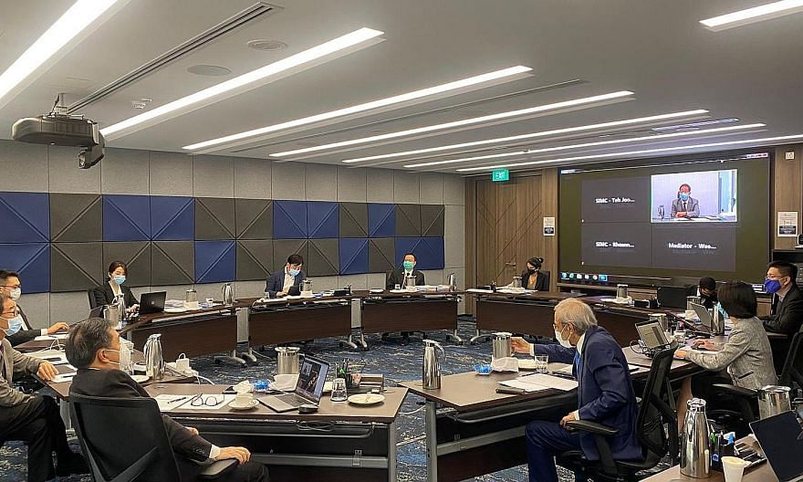 A mediation session hosted by the Singapore International Mediation Centre, with participants from overseas linked up via videoconferencing facilities. This photo was taken with the consent of all parties present. Against the backdrop of Covid-19, mo
