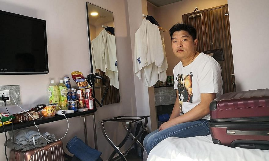"Mr Eddie Chow, seen below in a video call with his family, said his wife ""is being left alone to take care of our eight-month-old son and five-year-old daughter"". PHOTOS: GAIN CITY"