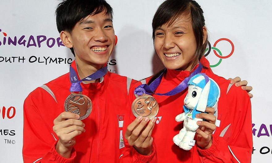 Taekwondo exponents Daryl Tan and Shafinas Abdul Rahman, who each won a bronze in the 55kg category of the 2010 Youth Olympics, are no longer active in the sport. ST FILE PHOTO