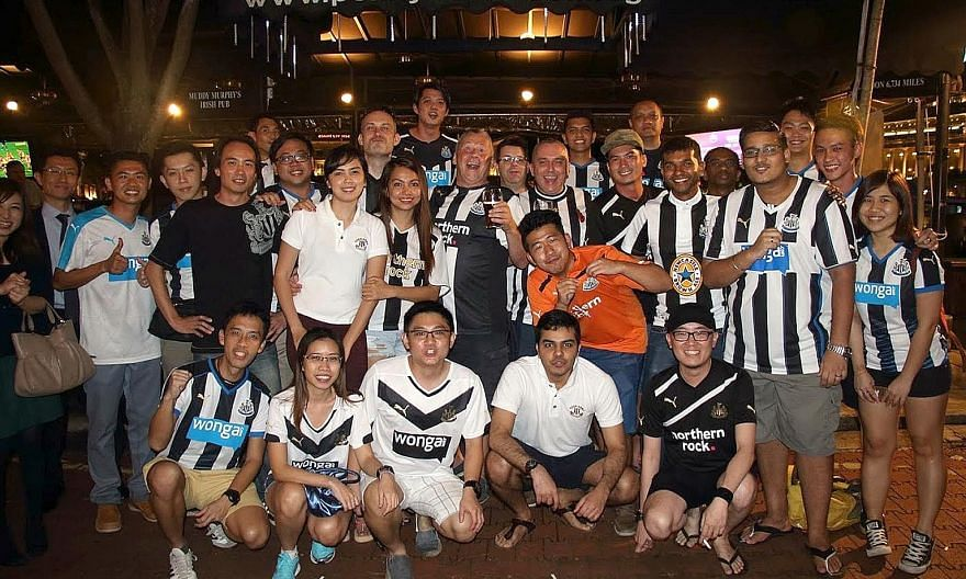 David Alexander (front row, far left) with fellow members of Newcastle United Supporters Club Singapore gathering to watch a match at Boat Quay. PHOTO COURTESY OF DAVID ALEXANDER