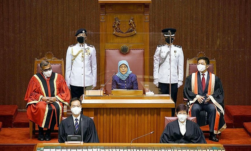 President Halimah Yacob at the opening of the 14th Parliament yesterday, flanked by Chief Justice Sundaresh Menon (far left) and Speaker of Parliament Tan Chuan-Jin. For the first time, the event took place at two locations - Parliament House and the