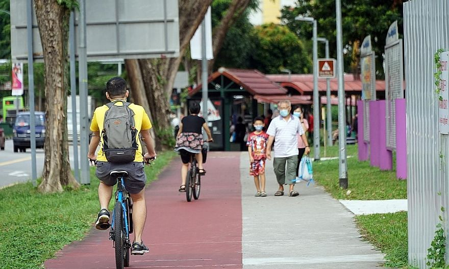 "Cyclists in Ang Mo Kio earlier this month. Transport Minister Ong Ye Kung said yesterday the reduced traffic and new travel patterns created by Covid-19 have opened a ""window of opportunity to reimagine"" the road infrastructure, and certain underused"