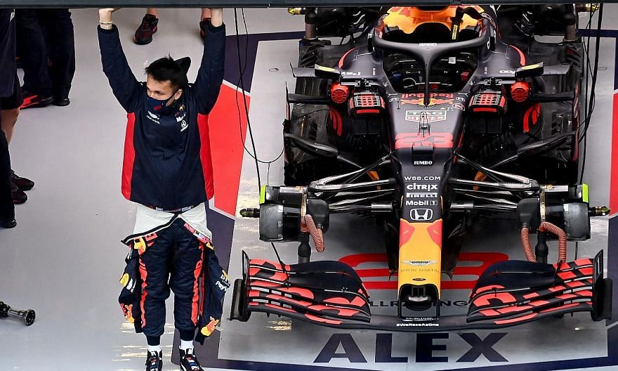 Red Bull's Alexander Albon in his garage during the July 10-12 Steiermark Grand Prix in Austria where he finished fourth, tying for the best result of his Formula One career. PHOTO: AGENCE FRANCE-PRESSE
