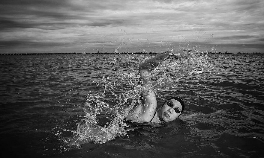 National open-water swimmer Chantal Liew training in the sea and posing out of it. ST PHOTOS: KEVIN LIM