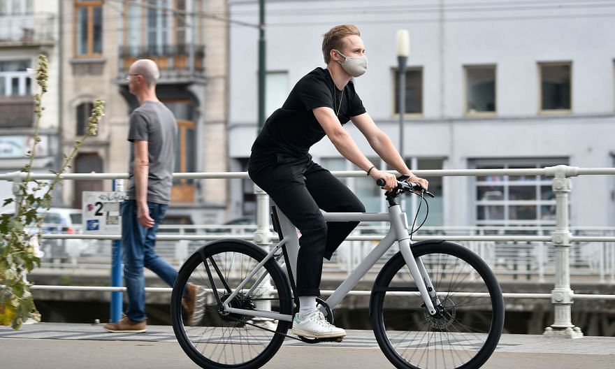 A man riding an e-bike in Belgium. The popularity of these pedal-assisted bicycles has surged in many countries during the coronavirus pandemic.