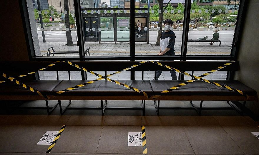 A taped-off seating area at a Seoul cafe yesterday. The health authorities have focused efforts on discouraging social gatherings of people aged between 20 and 40, who accounted for nearly 40 per cent of confirmed Covid-19 cases last week. This has l