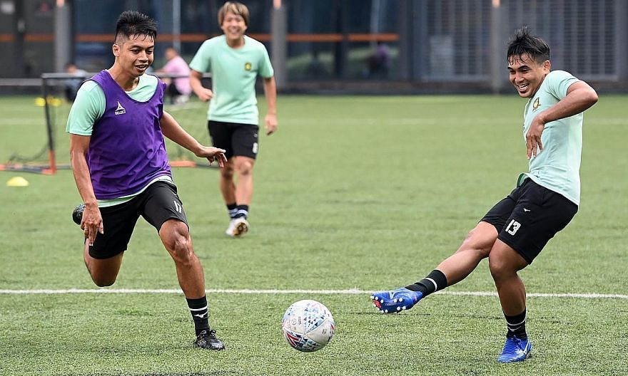 Tampines forward Taufik Suparno (right) and defender Irwan Shah having fun during training. The SPL leaders were the first team to return to training when Singapore moved to phase two of post-circuit breaker measures in June. PHOTO: FACEBOOK/ TAMPINE