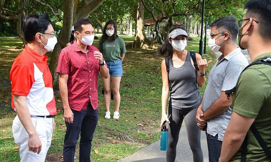 Deputy Prime Minister Heng Swee Keat (left) and fellow East Coast GRC MP Tan Kiat How (second from left) engaging Ms Samantha Thian and fellow volunteers who regularly clean the beach at East Coast Park. Partnerships between citizens and the Governme
