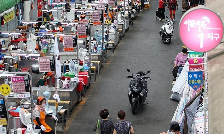 Daegu's Seomun Market saw few visitors amid tightened social distancing rules yesterday. Once hailed as a role model for successfully curbing the Covid-19 outbreak, South Korea is now struggling to cope with fresh cases. PHOTO: EPA-EFE