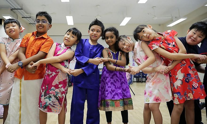 Primary school pupils celebrating Racial Harmony Day last year. Minister for Culture, Community and Youth Edwin Tong said common spaces like schools, libraries and public housing, where all races interact, promote a more open and shared outlook acros