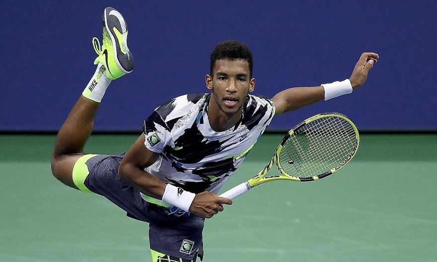 Above: Felix Auger-Aliassime serving during his second-round match against Britain's Andy Murray. The Canadian smashed 24 aces and 52 winners in a 6-2, 6-3, 6-4 victory. Left: Murray could muster only two aces and nine winners. PHOTOS: AGENCE FRANCE-