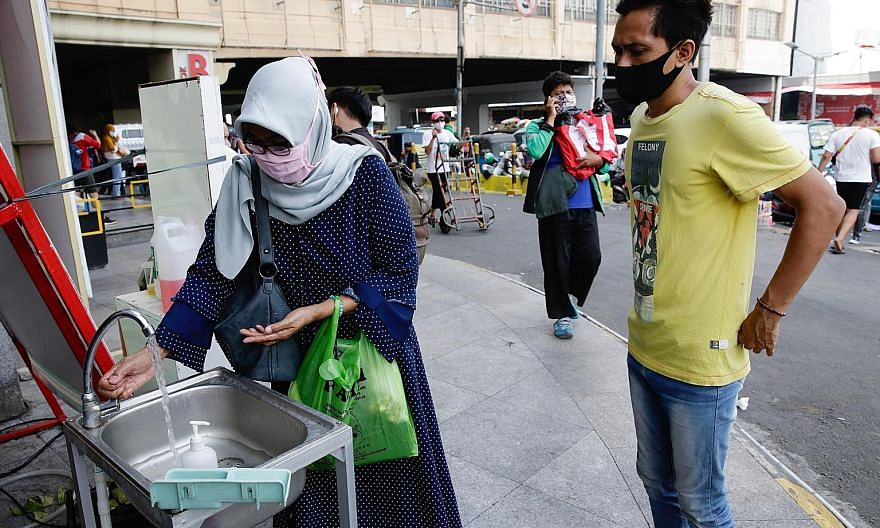 A visitor washing her hands before entering a shopping mall in Jakarta yesterday. Java, where Jakarta is located, accounts for 57 per cent of all infections in the country. The Jakarta government has come under fire for a lack of enforcement against
